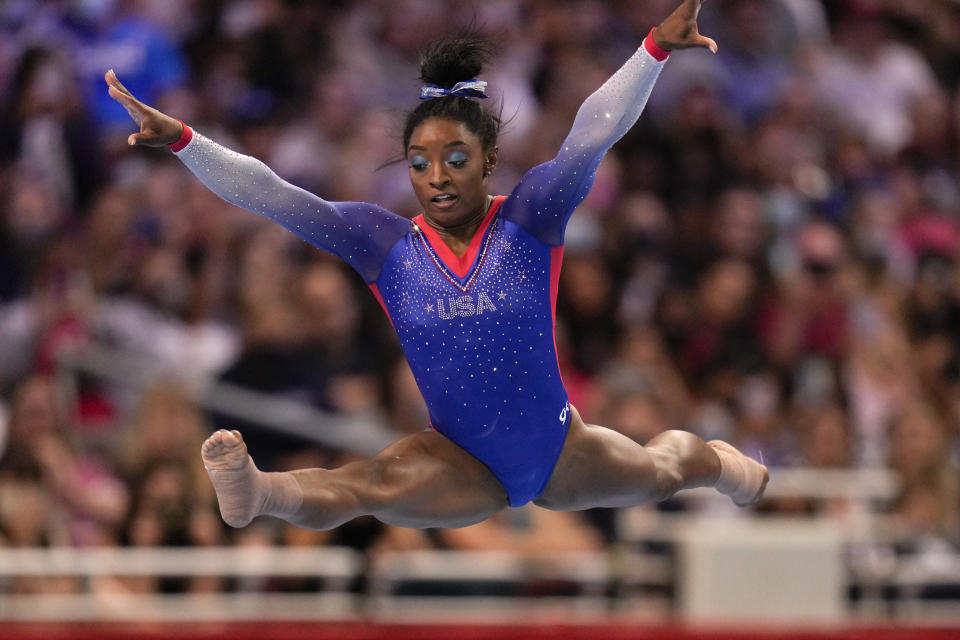 FILE - Simone Biles competes in the floor exercise during the women's U.S. Olympic Gymnastics Trials in St. Louis, in this Friday, June 25, 2021, file photo. Three-quarters of the 613-person U.S. Olympic team that was released Tuesday competed in the American collegiate system — the most up-to-date number to illustrate the country's dependence on NCAA and other college programs to bring home medals. Biles, who is a top contender for multiple gold medals, is making her second Olympic appearance. (AP Photo/Jeff Roberson, File)