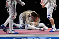<p>Italy's Luca Curatoli (C) celebrates with his teammates after scoring the final point against Hungary's Aron Szilagyi compete against in the men's sabre team semifinal bout during the Tokyo 2020 Olympic Games at the Makuhari Messe Hall in Chiba City, Chiba Prefecture, Japan, on July 28, 2021. (Photo by Mohd RASFAN / AFP)</p>
