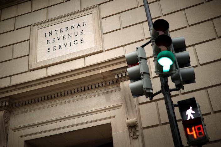The IRS recently called back some employees into the office to work on taxpayer correspondence, handling tax documents, taking telephone calls and other actions related to the tax filing season. (Chip Somodevilla/Getty Images)