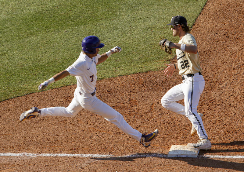 Vanderbilt first baseman Julian Infante (22) beats LSU's Giovanni DiGiacomo (7) to the bag for an out during the third inning of the Southeastern Conference tournament NCAA college baseball game, Saturday, May 25, 2019, in Hoover, Ala. (AP Photo/Butch Dill)