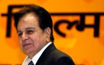 FILE PHOTO: Bollywood star Dilip Kumar smiles after receiving an award in New Delhi
