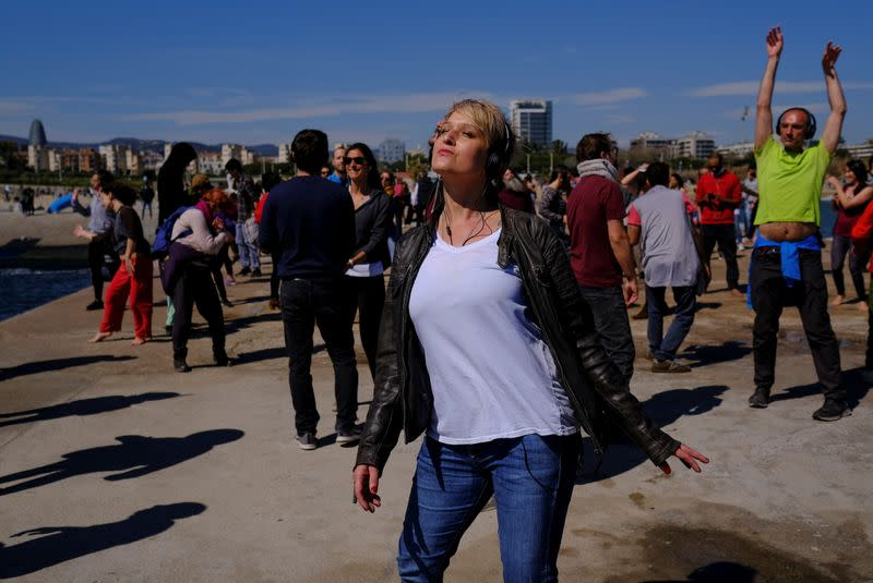 People join socially-distant silent disco in Barcelona