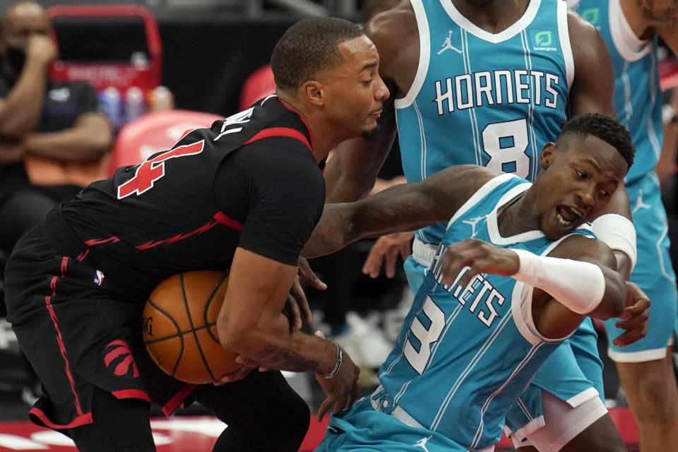 Toronto Raptors guard Norman Powell (24) runs into Charlotte Hornets guard Terry Rozier (3) during the second half of an NBA basketball game Saturday, Jan. 16, 2021, in Tampa, Fla. (AP Photo/Chris O'Meara)