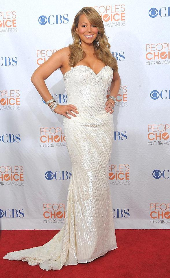 "After her wacky acceptance speech at the Palm Springs International Film Festival just days ago, we were surprised to see Favorite R&B Artist winner Mariah Carey in attendance ... and looking as good as she did in a beaded Ysa Makino gown. Jason Merritt/<a href=""http://www.gettyimages.com/"" target=""new"">GettyImages.com</a> - January 6, 2010"