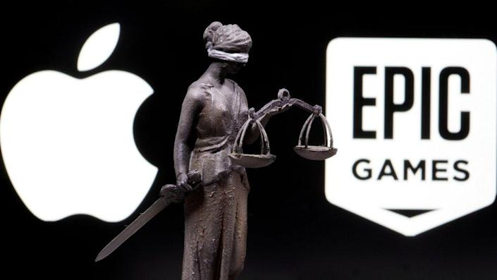 The Apple logo, the Epic logo, and a 3D-printed statue of the personification of Justice with sword and scales between them