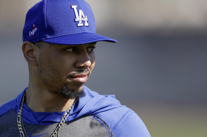 Los Angeles Dodgers outfielder Mookie Betts looks on during spring baseball training Monday, Feb. 17, 2020, in Phoenix. (AP Photo/Gregory Bull)