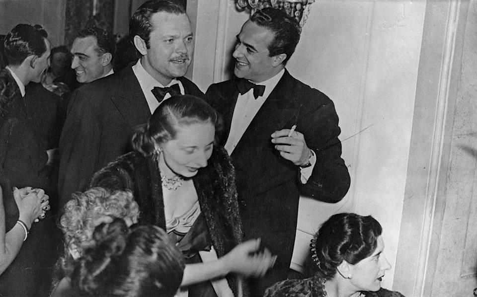 <p>American actor Orson Welles at a Fashion ball in Rome, Italy.</p><p>Other celebrity visitors this year: actor Kirk Douglas, Louis Armstrong.<br></p>