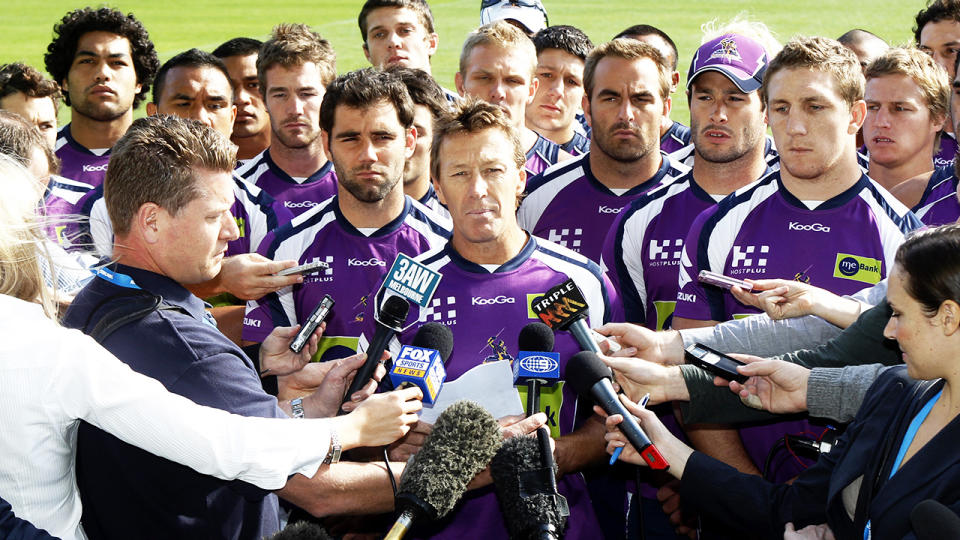 Craig Bellamy and the Melbourne Storm players, pictured here addressing the cheating scandal in 2010.