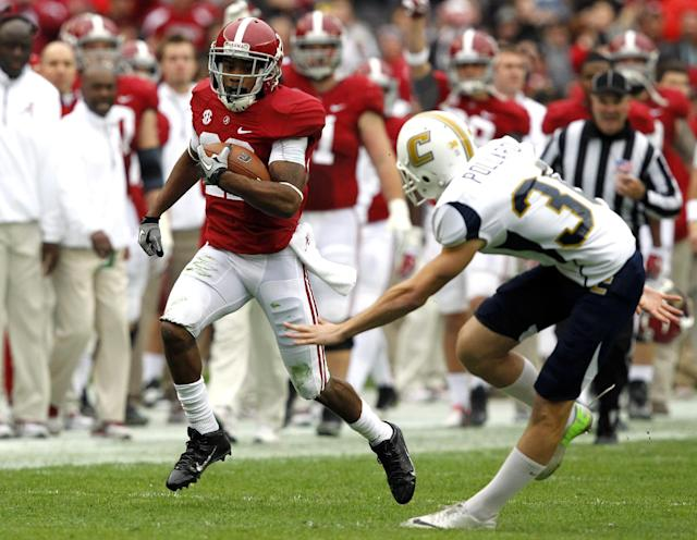 Alabama wide receiver Christion Jones (22) gets past Chattanooga kicker Nick Pollard (30) and returns a punt for a touchdown during the first half of an NCAA college football game on Saturday, Nov. 23, 2012, in Tuscaloosa, Ala. (AP Photo/Butch Dill)