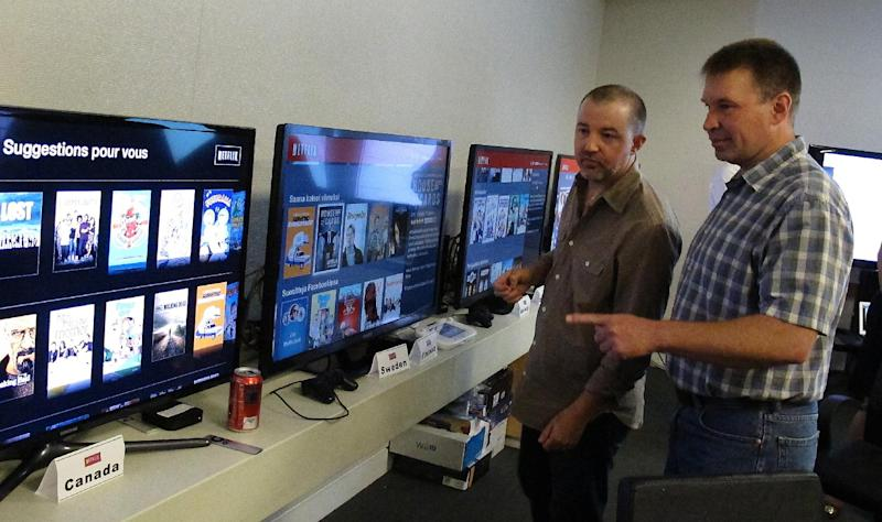 """In this photo taken Wednesday, July 10, 2013, Chris Jaffee, Netflix VP of Product Innovation, left, and Bob Heldt, Director of Engineering, look over video displays as they await the debut of """"Orange is the new black"""" in Los Gatos, Calif. (AP Photo/Michael Liedtke)"""