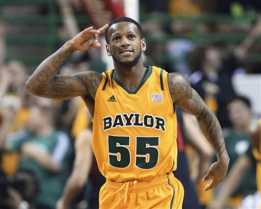 Baylor's Brady Heslip reacts to his 3-point shot against Texas Tech in the first half of an NCAA college basketball game, Saturday, Feb. 9, 2013, in Waco, Texas. (AP Photo/Waco Tribune Herald, Rod Aydelotte)