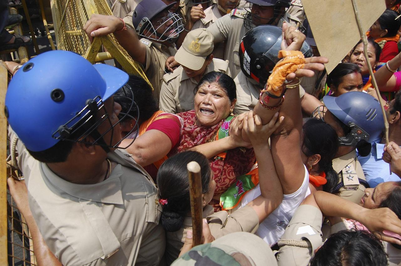Supporters of Bharatiya Janata Party (BJP) are stopped by police from moving towards the office of Akhilesh Yadav, the chief minister of the northern Indian state of Uttar Pradesh, during a protest against recent rape and hanging of two girls, in Lucknow June 2, 2014. Three men were arrested for the crime in Uttar Pradesh that underscored the enduring culture of sexual assault in India and the capacity for appalling violence between Hindu castes. Two policemen were held on suspicion of attempting to cover up the killings. On Monday, Modi's BJP sought to make political capital. Workers from the party accused the Uttar Pradesh state government, headed by Samajwadi Party, of negligence over the crimes and of being unfit to govern. Police fired water cannon at the protesters, who were demanding the state government be dismissed and the imposition of direct, presidential rule. REUTERS/Pawan Kumar (INDIA - Tags: POLITICS CRIME LAW CIVIL UNREST)