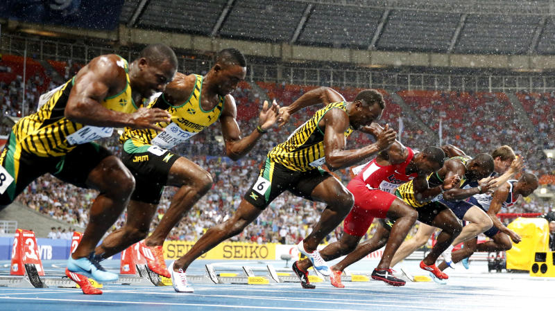From right, Britain's James Dasaolu, France's Christope Lemaitre. Jamaica's Nickel Ashmeade, USA's Justin Gatlin, Jamaica's Usain Bolt, Jamaica's Kemar Bailey-Cole and Jamaica's Nesta Carter start in the Men's 100-meter final at the World Athletics Championships in the Luzhniki stadium in Moscow, Russia, Sunday, Aug. 11, 2013. (AP Photo/Matt Dunham)