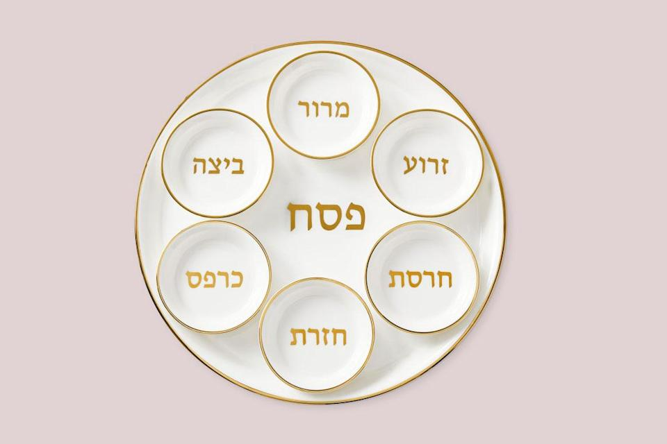 """<p>Glazed porcelain is trimmed in 24 karat gold for a gorgeous and stylish finish that can be passed down through the generations. The inscription on the serving plate says <em>Pesach</em>, which means Passover in Hebrew.</p> <p><em><strong>Shop Now:</strong></em><em> Williams Sonoma Seder Plate Set, $99.95, <a href=""""https://williams-sonoma.pdy5.net/c/249354/265127/4291?subId1=MSL10PassoverSederPlatesGuaranteedtoBecomeYourNextFamilyHeirloomachurchiPasGal8067612202103I&u=https%3A%2F%2Fwww.williams-sonoma.com%2Fproducts%2Fseder-plate-set%2F%3FcatalogId%3D79%26amp%3Bsku%3D7067062"""" rel=""""sponsored noopener"""" target=""""_blank"""" data-ylk=""""slk:williams-sonoma.com"""" class=""""link rapid-noclick-resp"""">williams-sonoma.com</a>.</em></p>"""