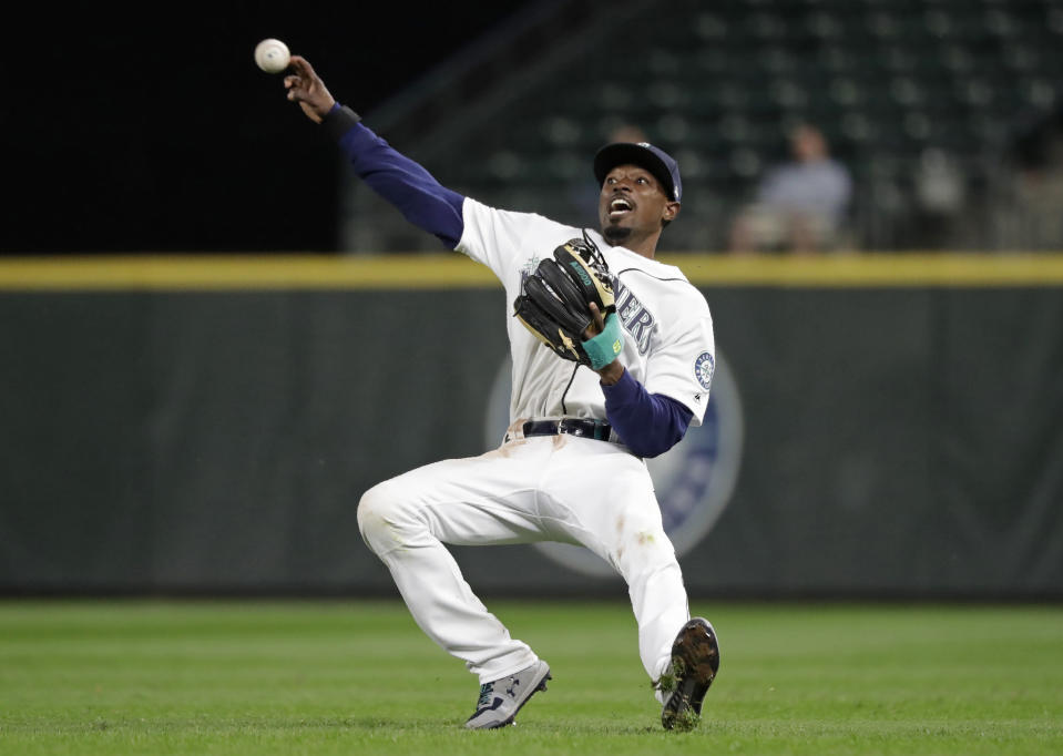 Seattle Mariners second baseman Dee Gordon throws to first for the out on a grounder by Kansas City Royals' Alex Gordon during the ninth inning of a baseball game Tuesday, June 18, 2019, in Seattle. (AP Photo/Elaine Thompson)