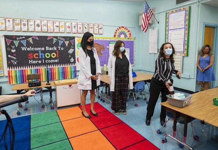 """Los Angeles, CA - July 26: Dr. Smita Malhotra, left, medical director, and Dr. Rosina Franco, middle, listen to Josefina Flores, right, Euclid Avenue Elementary School principal, speak in a classroom at a L.A. Unified """"meet and greet"""" with its medical advisors as they answer questions and present the safety preparations at Euclid Avenue Elementary School Monday, July 26, 2021 in Los Angeles, CA. Parents have until Friday to choose whether to return their children to in-person classes or remain online in the fall. The first day of school is in mid-August. (Allen J. Schaben / Los Angeles Times)"""
