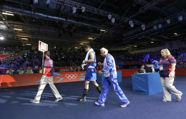 """Olympic judges and referees came under fire with one fighter accusing them of """"a fix,"""" another successfully appealing a loss and even boxing great Lennox Lewis questioning some of their calls. Iran's Ali Mazaheri cried foul when the heavyweight was disqualified after being warned three times for persistent holding against Cuban Jose Larduet Gomez despite leading by two points going into the second round."""