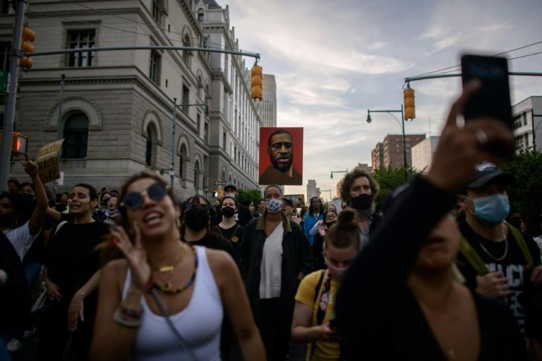 Black Lives Matter protesters in New York on the anniversary of the death of George Floyd, who was murdered by a white officer