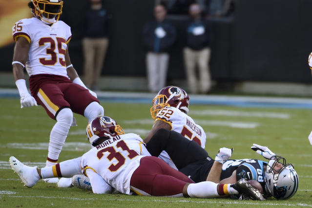 Carolina Panthers tight end Greg Olsen took a brutal hit on Sunday in their loss to the Redskins, and is recovering in concussion protocol. (AP/Mike McCarn)