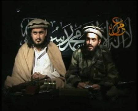 Taliban leader Hakimullah Mehsud (L) sits beside a man who is believed to be Humam Khalil Abu-Mulal Al-Balawi, the suicide bomber who killed CIA agents in Afghanistan, in this file still image taken from video released January 9, 2010. REUTERS/Tehrik-i Taliban Pakistan via Reuters TV/Files