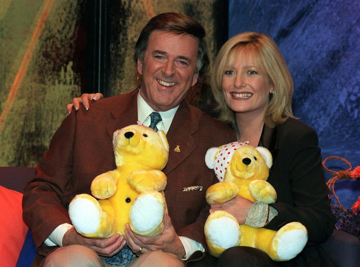 Presenters Gaby Roslin and Terry Wogan during their marathon broadcast to raise money for the BBC Children in Need Appeal tonight (Friday). Photo by Michael Stephens/PA.  * 17/11/2000 Gaby Roslin and Terry Wogan during their marathon broadcast to raise money for the BBC Children in Need Appeal.  Stars from the world of television, pop and sport are taking part in the 21st televised BBC Children in Need Appeal Friday November 17th, 2000. Presenters Wogan and Roslin are hosting the event in the studio  and across the country celebrities and members of the public will help raise much needed funds for the charity.   (Photo by Michael Stephens - PA Images/PA Images via Getty Images)