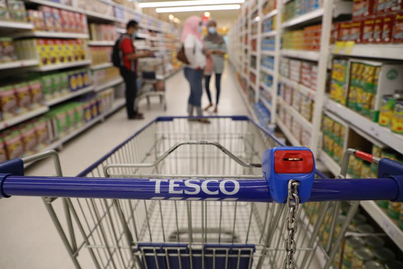 FILE PHOTO: A shopping cart is pictured in a Tesco supermarket, amid the coronavirus disease (COVID-19) outbreak in Petaling Jaya
