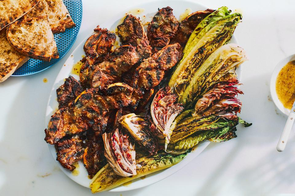 "Easy grilled short ribs benefit from a bittersweet and mustardy orange marmalade marinade, and those flavors reappear as a dressing on grilled romaine and radicchio. <a href=""https://www.epicurious.com/recipes/food/views/grilled-short-ribs-and-lettuces-with-mustard-orange-dressing?mbid=synd_yahoo_rss"" rel=""nofollow noopener"" target=""_blank"" data-ylk=""slk:See recipe."" class=""link rapid-noclick-resp"">See recipe.</a>"