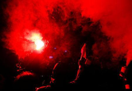 """Anti-fascist activists with a flare react during an open air """"anti-racism concert"""" in Chemnitz, Germany, September 3, 2018. REUTERS/Hannibal Hanschke"""