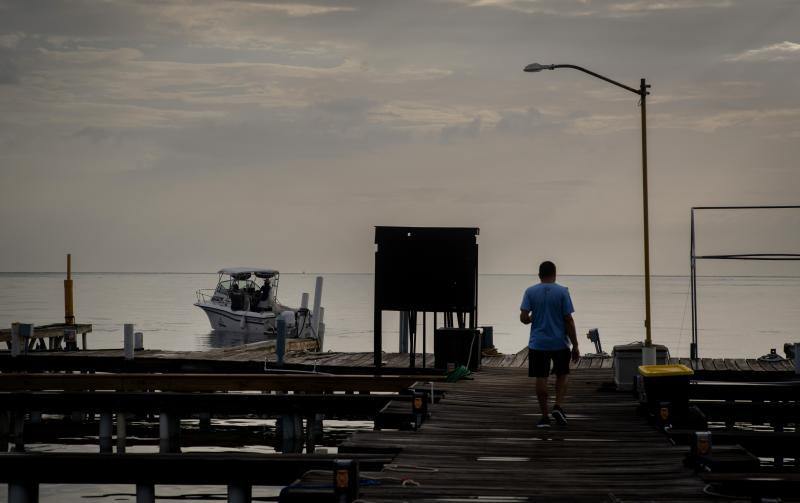 A man arrives to a private harbor to move boats away for protection ahead of the arrival of Tropical Storm Dorian in Boqueron, Puerto Rico, Aug. 27, 2019. (Photo: Ramon Espinosa/AP)