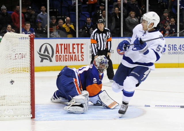 Tampa Bay Lightning' Valtteri Filppula (51) scores the first goal past New York Islanders goalie Evgeni Nabokov during a shootout in an NHL hockey game on Tuesday, Dec. 17, 2013, in Uniondale, N.Y. Filppula scored two goals during the Lightning's 3-2 win. (AP Photo/Kathy Kmonicek)