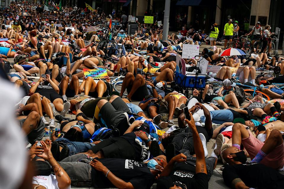 People lie onn the street for a die-in to support the LGBTQ community and the Black Lives Matter movement in Minneapolis, Minnesota, U.S., June 28, 2020.