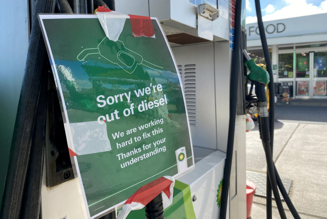 WEYMOUTH, ENGLAND - SEPTEMBER 24: A sign reading 'Sorry we're out of diesel' is seen at a BP petrol station on September 24, 2021 in Weymouth, England. BP and Esso have announced that its ability to transport fuel from refineries to its branded petrol station forecourts is being impacted by the ongoing shortage of HGV drivers and as a result, it will be rationing deliveries to ensure continuity of supply. (Photo by Finnbarr Webster/Getty Images)