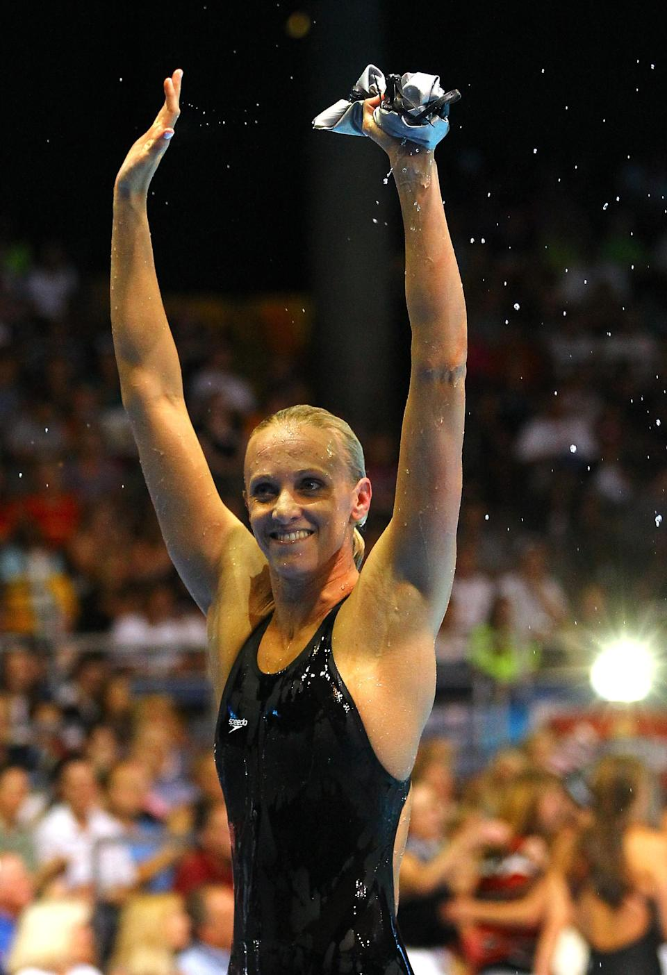 OMAHA, NE - JUNE 26: Dana Vollmer celebrates after she finished first in the championship final heat of the Women's 100 m Butterfly during Day Two of the 2012 U.S. Olympic Swimming Team Trials at CenturyLink Center on June 26, 2012 in Omaha, Nebraska. (Photo by Al Bello/Getty Images)