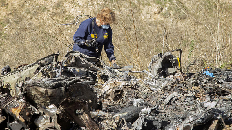 A National Transportation Safety Board investigator, pictured here at the scene of the helicopter crash.