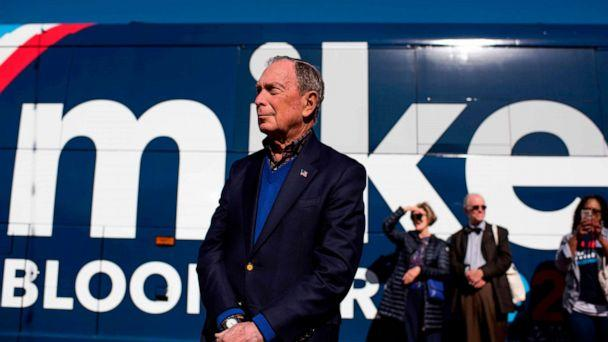 PHOTO: Democratic presidential candidate Mike Bloomberg waits by his tour bus ahead of addressing his supporters at Central Machine Works in Austin, Texas on Jan. 11, 2020. (Mark Felix/AFP via Getty Images)