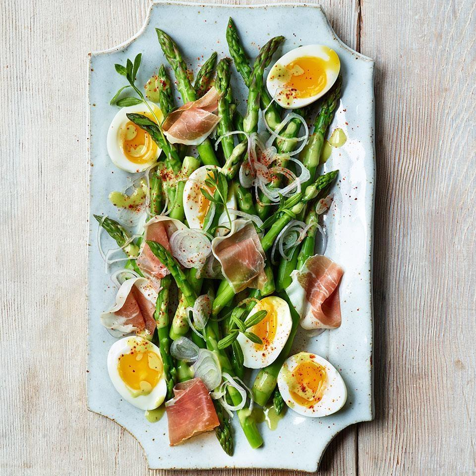 <p>This impressive-looking asparagus salad recipe is actually very easy to make. After quickly boiling the asparagus, the same water is used to soft-boil the eggs. Piment d'Espelette is a sweet, spicy ground pepper from the Basque region of France. While it's not essential, it does add a subtle kick to the otherwise mellow flavors of this salad. Look for this spice at specialty stores and well-stocked markets--or substitute smoked paprika.</p>