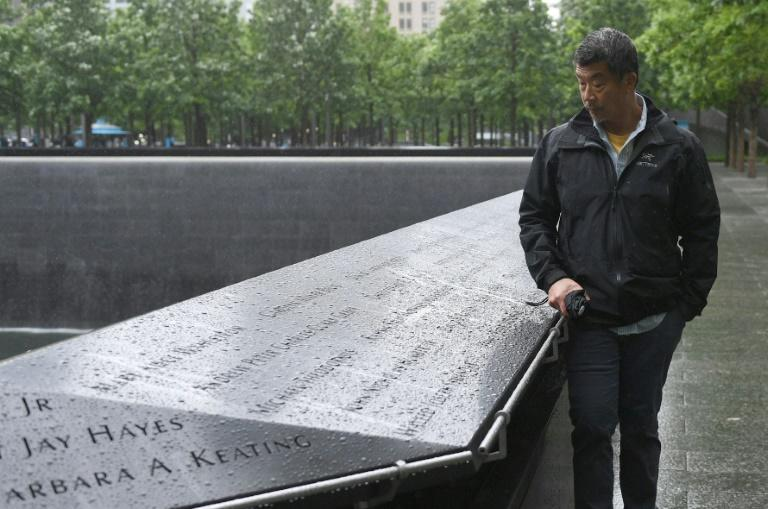 """Al Kim reads the names of 9/11 victims during a visit to the """"Ground Zero"""" memorial"""