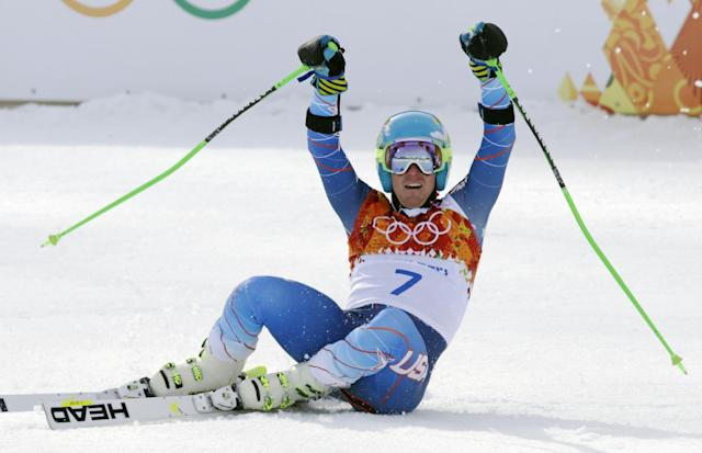 United States' Ted Ligety celebrates after winning the gold medal in the men's giant slalom at the Sochi 2014 Winter Olympics, Wednesday, Feb. 19, 2014, in Krasnaya Polyana, Russia.(AP Photo/Gero Breloer)