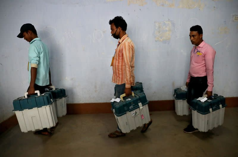 Election workers carry Voter Verifiable Paper Audit Trail (VVPAT) machines, in Purulia