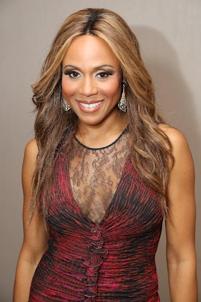 """In this Saturday, Sept. 8, 2012 photo, cast member Deborah Cox poses during the party for the opening night performance of """"Jekyll & Hyde"""" The Musical at the La Mirada Theatre for the Performing Arts, in La Mirada, Calif. Cox loves the """"beginning of a new chapter"""" as she brings """"Jekyll and Hyde"""" to Broadway. (Photo by Ryan Miller/Invision/AP)"""