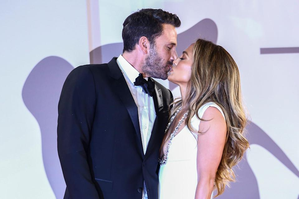 Jennifer Lopez, right, and Ben Affleck kiss upon arrival at the premiere of the film 'The Last Duel' during the 78th edition of the Venice Film Festival in Venice, Italy, Friday, Sept. 10, 2021. (Photo by Joel C Ryan/Invision/AP) ORG XMIT: LENT177
