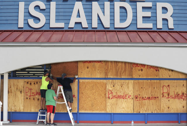 <p>Workers cover a business with plywood in preparation for Hurricane Harvey, Thursday, Aug. 24, 2017, in Corpus Christi, Texas. (AP Photo/Eric Gay) </p>