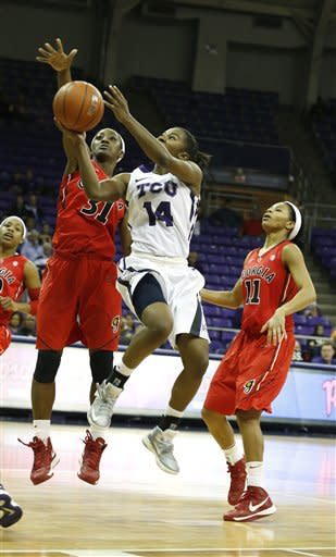 Georgia guards Erika Ford (31) and Tiara Griffin (11) defend as TCU guard Zahna Medley (14) shoots in the first half of an NCAA women's college basketball game on Wednesday, Dec. 19, 2012, in Fort Worth, Texas. (AP Photo/Sharon Ellman)