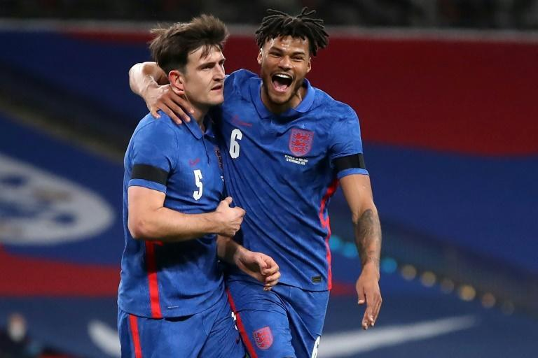 England defender Harry Maguire (L) celebrates with Tyrone Mings