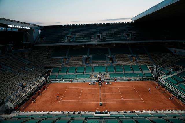 Roger Federer needed three hours and 35 minutes to clinch a 7-6 (5) 6-7 (3) 7-6 (4) 7-5 victory over Germany's Dominik Koepfer during an empty Roland Garros at midnight but pulled out the following day to preserve his chances of playing at Wimbledon later this month