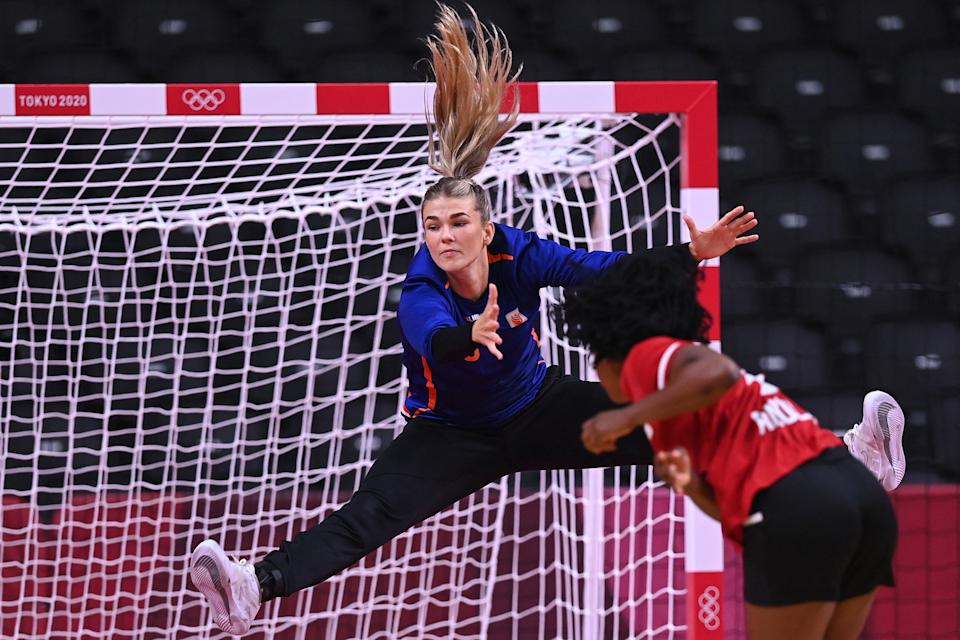 <p>Netherlands' goalkeeper Tess Wester jumps to save during the women's preliminary round group A handball match between The Netherlands and Angola of the Tokyo 2020 Olympic Games at the Yoyogi National Stadium in Tokyo on July 29, 2021. (Photo by Daniel LEAL-OLIVAS / AFP)</p>