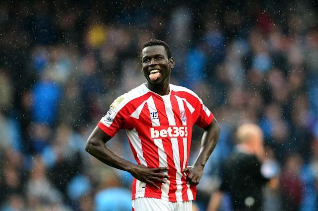"""Stoke City's Senegalese forward Mame Biram Diouf, who scored Stoke City's winning goal, reacts at the final whistle during the English Premier League football match between Manchester City and Stoke City at the Etihad Stadium on August 30, 2014 RESTRICTED TO EDITORIAL USE. No use with unauthorized audio, video, data, fixture lists, club/league logos or """"live"""" services. Online in-match use limited to 45 images, no video emulation. No use in betting, games or single club/league/player publications (AFP Photo/Carl Court)"""