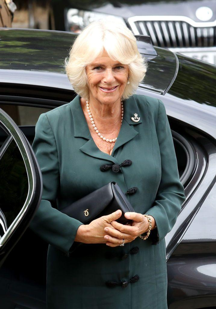 <p>The Duchess of Cornwall stepped out in a dark green ensemble paired with a classic pearl necklace and a sleek black bag while visiting soldiers at the New Normandy Barracks in England.</p>