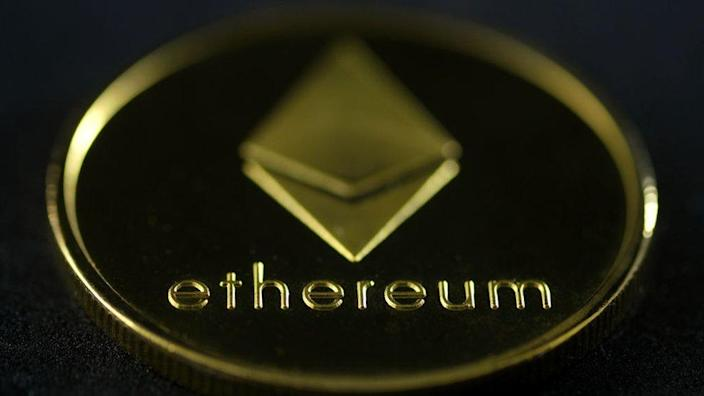 """An Etherium """"coin"""" featuring the name and diamond-shaped logo of the currency"""