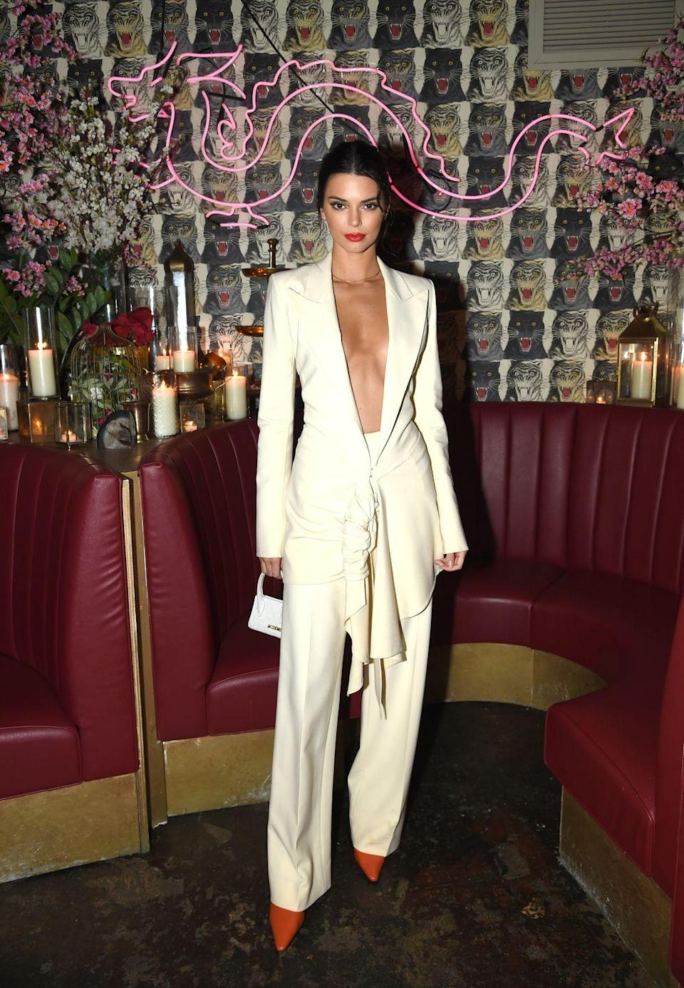 <p>Kendall wore a crisp off-white suit for the Business Of Fashion 'The Age Of Influence' party in NYC, May 2018. She teamed the with pointed-toe stiletto heels and carried a mini white handbag. </p>